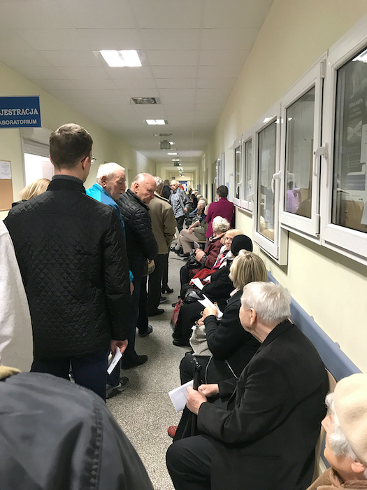 long line of patients at a hospital